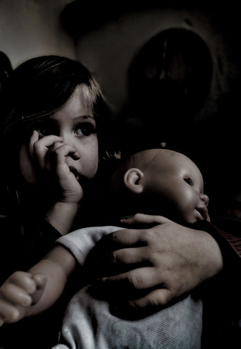 Portrait of cute girl holding baby girl