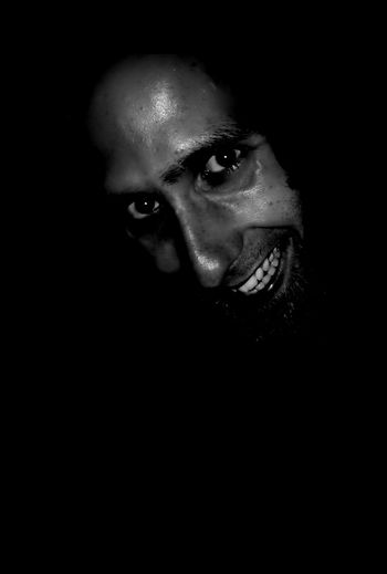 Scared in the dark??? Horror Self Portrait In The Dark Black & White Black And White Blackandwhite Scary Face Scary Grin Maniac Crazy Mad Looking Front View Human Face Dark Young Adult Body Part Human Body Part Copy Space Studio Shot Close-up Indoors  Black Background Looking At Camera One Person Headshot Portrait