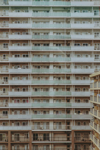 Balcony besides balcony; flat by flat. Endless rows of apartments in Tokyo. Japan The Graphic City Tokyo Apartment Apartment Block Appartment Architecture Balcony Building Exterior City Community In A Row No People Residential Building