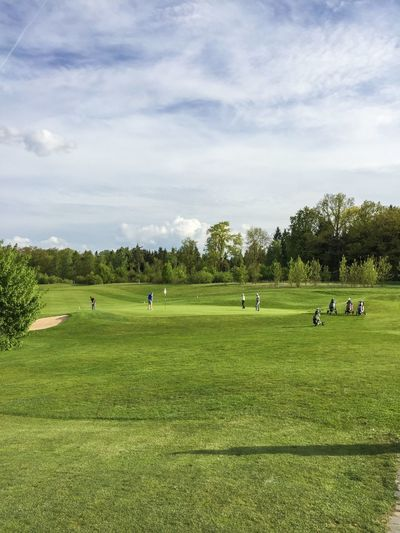 People playing golf on field
