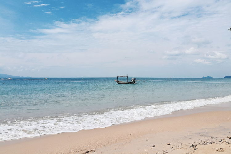 Beach Sand Sea Horizon Over Water Cloud - Sky Sky Travel Destinations Tourism Landscape Sunny Nature Wave Tranquil Scene Nautical Vessel Tranquility Vacations Backgrounds Day Water Summer