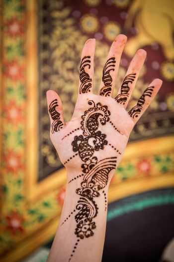 Human Hand Hand Human Body Part Tattoo Henna Tattoo Focus On Foreground One Person Body Part Adult Creativity Women Lifestyles Real People Close-up Showing Art And Craft Finger Floral Pattern Human Limb India Indian Henna Henna Art Hennatattoo Patterns