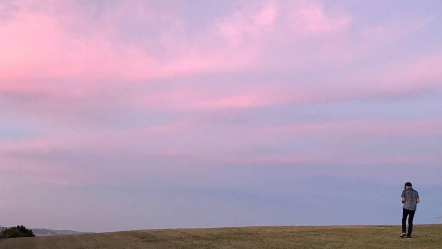 Full length of a man standing against sky