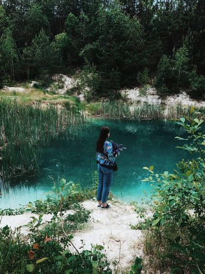 Real People Full Length Water One Person Nature Day Leisure Activity Beauty In Nature Lake Casual Clothing Outdoors Tree Lifestyles Standing Plant Growth Forest Young Women Young Adult People