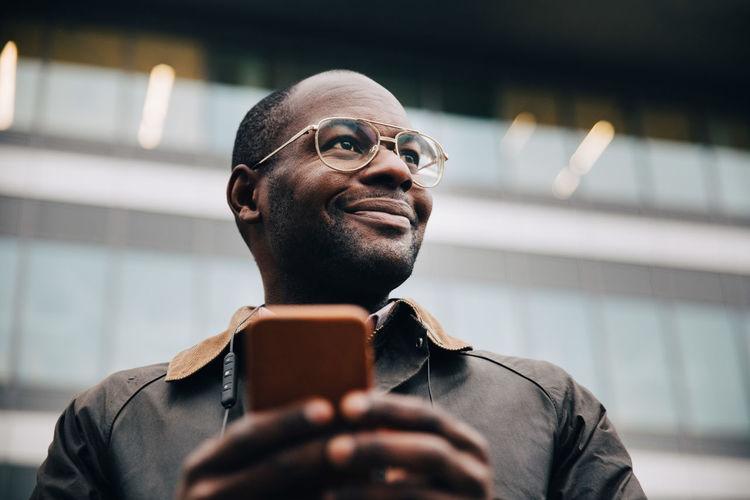 Portrait of man holding smart phone