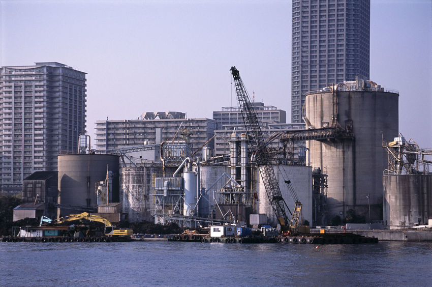 tokyo waterfront industrial area Building City Complex Complicated Crane Digger Dirty Engineering Gantries Gantry Harbor Industrial Mixer Outdoors Pipes Silo Tank Water