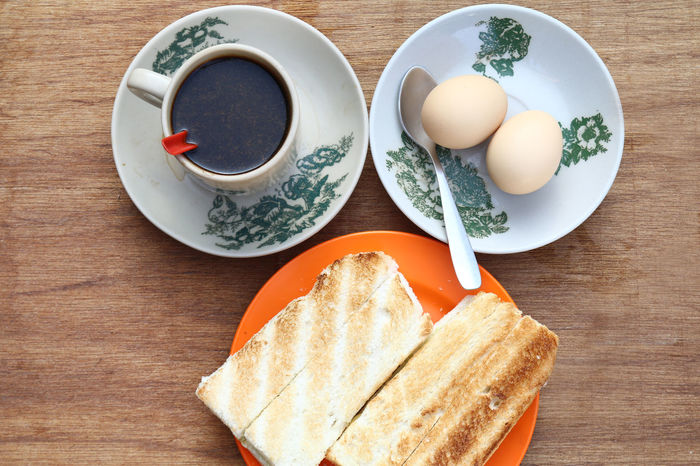 Breakfast set of toast, half boiled eggs and coffee. Popular in Malaysian and Singaporean coffeeshops. Breakfast Classic Coffee Coffeeshop Cup Eggs Food Half Boiled Eggs Kaya Kopitiam Malaysia Malaysian Meal Morning Singapore Singaporean Toast