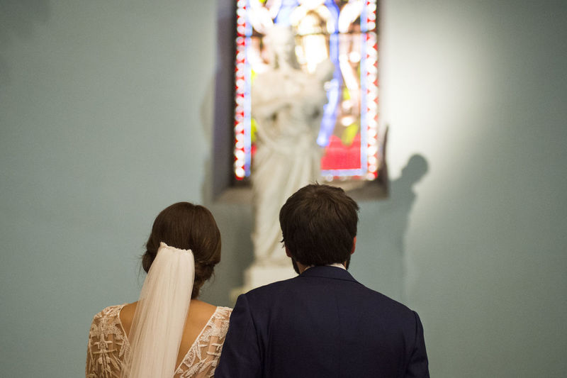 Rear view of couple standing in church