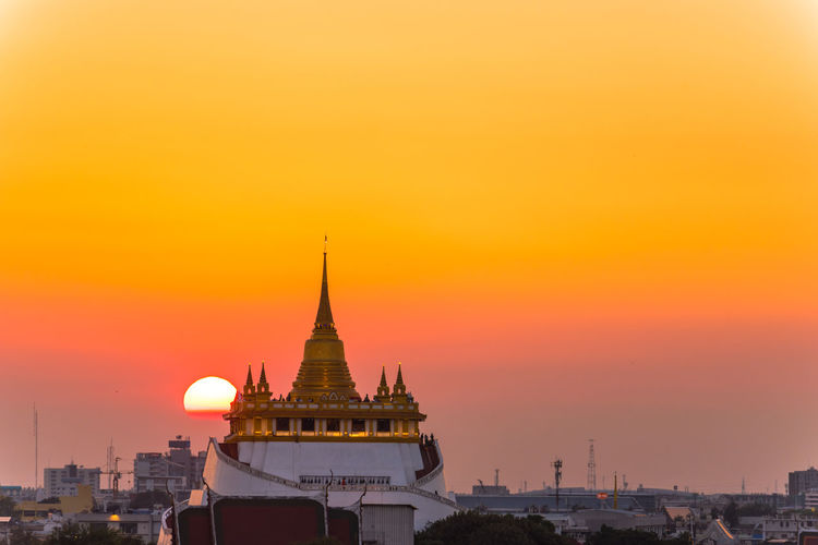 sunset over golden pagoda City Cityscape Urban Skyline Sunset Beauty Place Of Worship Gold Skyscraper Hot Air Balloon Religion Ancient Civilization Ancient Ancient History History Civilization Old Ruin