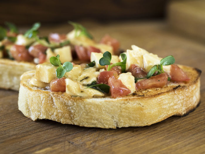 Close-up of open sandwich served in wooden plate