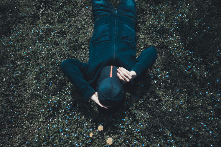 High angle view of person lying on ground