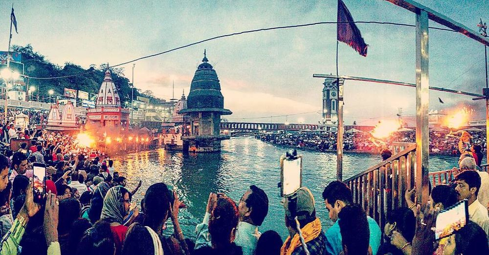 Travel Large Group Of People Travel Destinations Rain Outdoors Sunset Building Exterior Illuminated People Architecture Vacations Crowd Water Mightyganges Ganga Ghat Gangaarti Ganga Talao Ganga Canal Incredibleindia