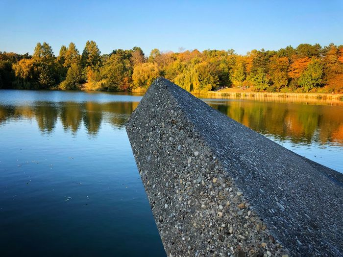 Stone lake Lake View Park Wood Sea Lake View Blue Blue Sky Sunset Oberlaa Lake Water Plant Tree Tranquility Reflection Sky Lake Nature Outdoors Idyllic Blue Tranquil Scene No People Clear Sky Day Non-urban Scene Beauty In Nature Growth Scenics - Nature