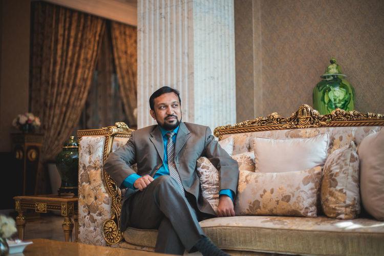 Portrait of smiling man sitting on seat