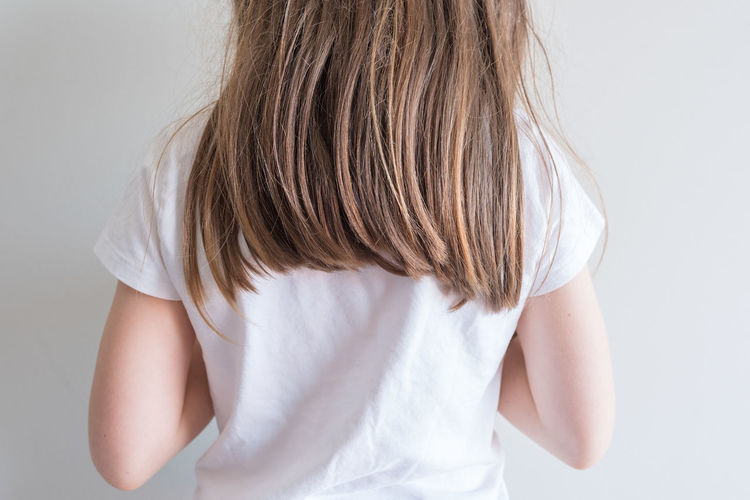 Little girl with long hair One Person Indoors  White Background Standing Studio Shot Waist Up Brown Hair Women Hairstyle Hair Casual Clothing Lifestyles White Color Rear View Child Long Hair Leisure Activity Females Human Hair Innocence