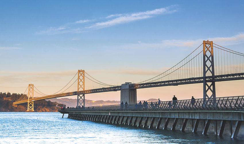 San franciscooakland bay bridge against blue sky