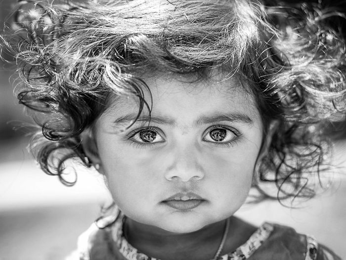 This was one of the most challenging shots for me. We pulled out every trick to get her to look into the camera, plus high new sun added to the challenge. A cloud moved right over us and I clicked, and got her big, beautiful eyes to look at me:) one of my fave shots. My Favorite Photo Bigeyes Black And White Blackandwhite Photography Blancoynegro C Childhood Children's Portraits Cute Showcase April Monochrome Photography Girls Headshot Human Face The Portraitist - 2016 EyeEm Awards Looking At Camera Outdoors People Person Portrait My Year My View South Telling Stories Differently Everyday Emotion Girl Power Fine Art Photography