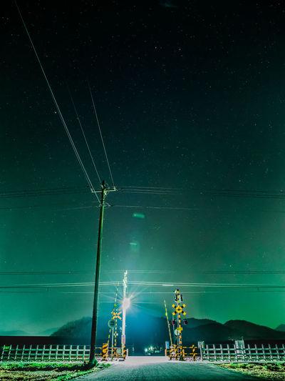 Illuminated railroad crossing at night