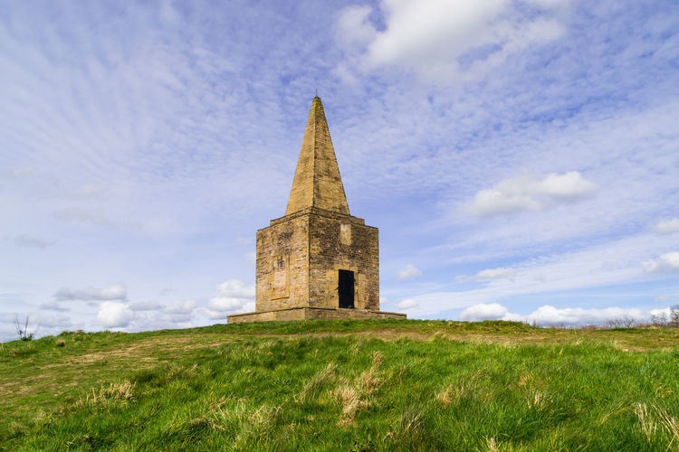 The Ashurst beacon on top of the hill in Dalton, Northwest, England. Architecture Background Beacon Building Exterior Built Structure Cloud - Sky Dalton Day England Field Grass Grassy Green Color History Lancashire Medieval No People Outdoors Sign Sky Spring Stone Material Uk Warning Sign Weathered