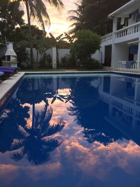 Architecture Beauty In Nature Building Exterior Built Structure Day Dominican Republic Growth House Nature No People Outdoors Palm Tree Reflection Sky Sunset Swimming Swimming Pool Tourist Resort Tranquility Tree Water EyeEmNewHere