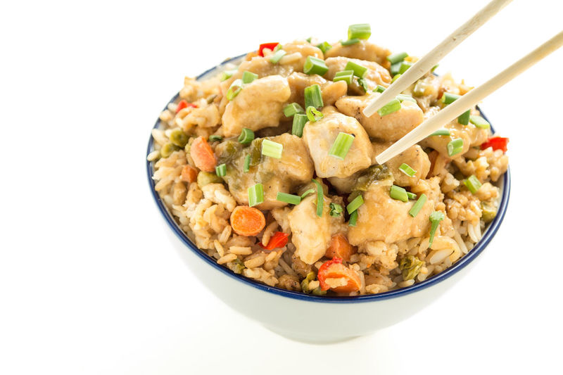 Orange Chicken with chopsticks Chinese Food Orange Chicken Bowl Chickens Chinese Food Chopsticks Delicious Food Fried Rice Healthy Nutritious Orange