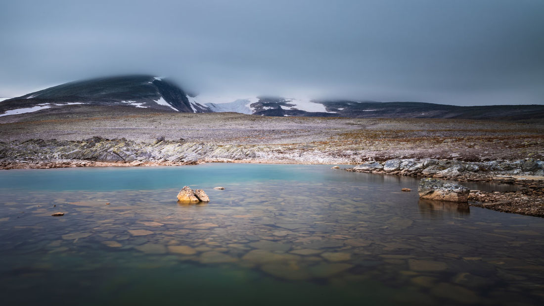 Small lake in front of the mountain Snøhetta, Dovre, Norway. Water Scenics - Nature Mountain Beauty In Nature Day Tranquil Scene Nature No People Tranquility Lake Landscape Environment Non-urban Scene Outdoors Pristine Snøhetta Dovrefjell Norway Freshness Fresh Blue Long Exposure