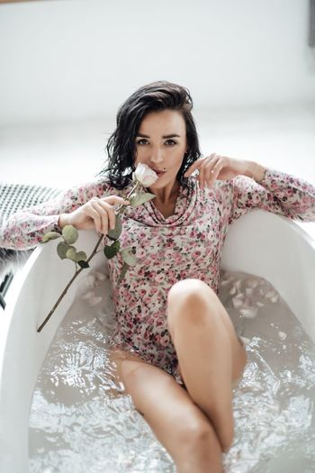 High angle portrait of beautiful woman relaxing in bathtub