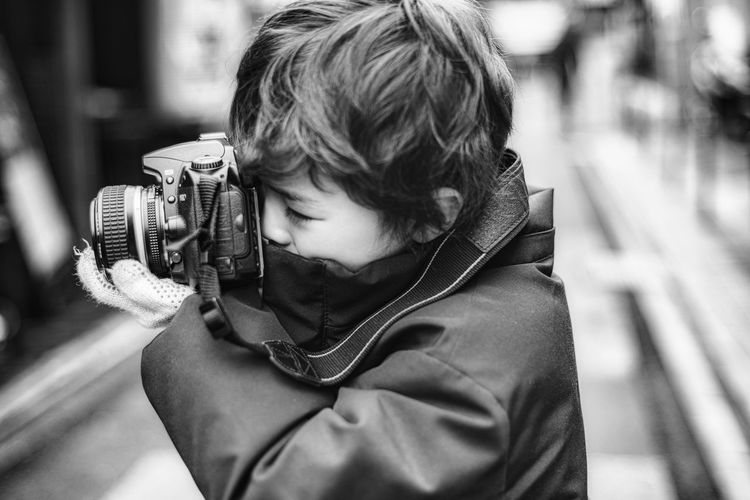 Close-up of boy holding camera