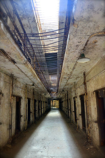 Alley Architecture Building Built Structure Cell Corridor Day Diminishing Perspective Empty Long Narrow No People Prison Prisoner Sky Surface Level The Way Forward Vanishing Point Walkway