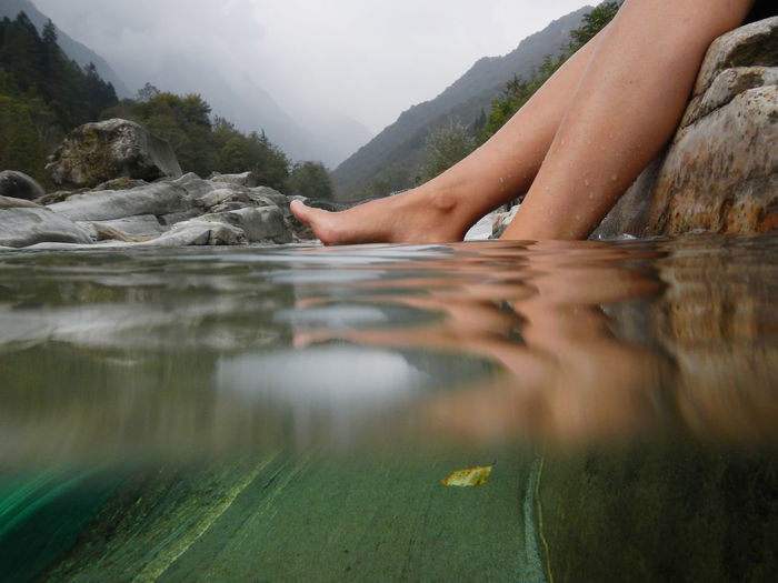 Feet in the Water Refreshment Woman Beauty In Nature Day Human Body Part Human Feet Human Leg Lake Leisure Activity Low Section Mountain Nature One Person One Woman Only Outdoors People Real People River Sea Side View Surface Surface Level Underwater Water Wet