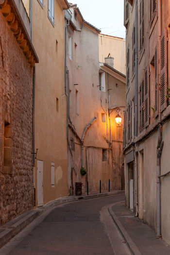 A narrow street at the Old town, Aix-en-Provence Architecture Building Building Exterior Built Structure City Diminishing Perspective Empty Footpath Illuminated Long Narrow No People Old Town Outdoors Residential District Street Street Light The Way Forward Town Townhouse