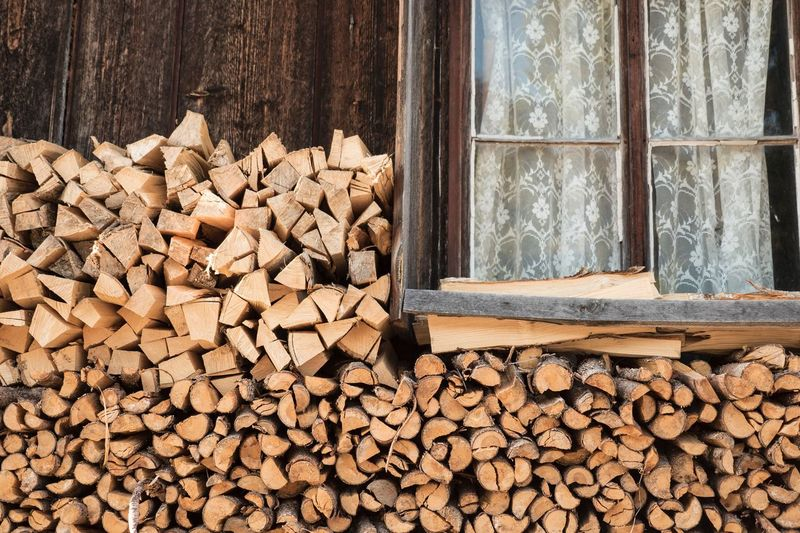 Heap Of Firewood By Window
