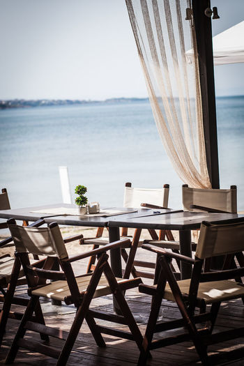 Balcony Beach Chair Clear Sky Curtain Day Dining Table Horizon Over Water Indoors  Nature No People Scenics Sea Sky Table Travel Travel Destinations Vacations Water