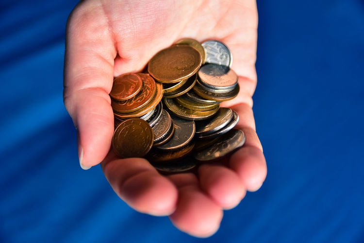Holding money. Currency Economy Investing In Quality Of Life Blue Colour Capital Contrasting Colours Different Currencies Hand Holding Holding Coins Holding Money Human Hand Investing Lifestyles Money Showing Money