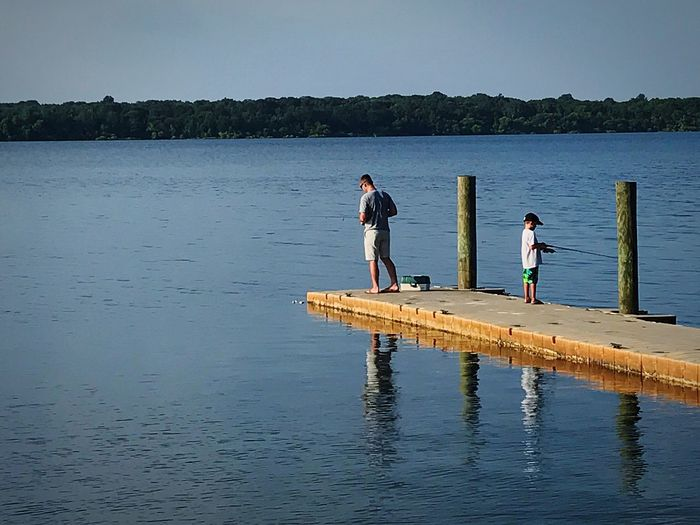 Lake Water Full Length Nature Leisure Activity Day Men Togetherness Reflection Boys Childhood Scenics Clear Sky Two People Child Outdoors Standing Father Tranquility Real People