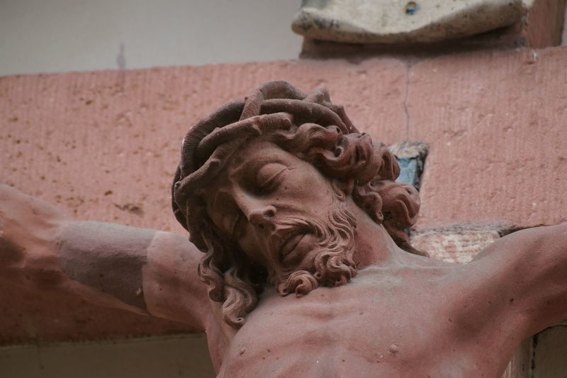 Close-up of statue against water