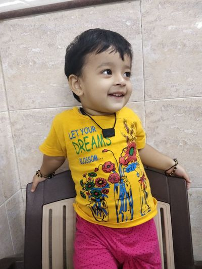 Childhood Child One Person Real People Casual Clothing Three Quarter Length Lifestyles Cute Leisure Activity Boys Front View Males  Men Innocence Yellow Women Girls Hairstyle