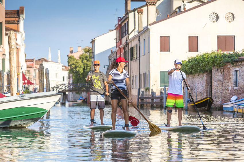 Standup-paddling in Venice, Italy Activity Adult Adventure Canale  Canale Grande Cruising Excursion Exploring Fun Gondola - Traditional Boat Having Fun Italy Outdoors Paddleboarding Paddling Sightseeing Smiling Standup Standup Paddleboarding Standuppaddle Sup Travel Vacations Venedig Water