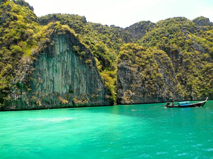 Maya Beach Thailand Beauty In Nature Green Color Idyllic Mountain Nature Nautical Vessel No People Outdoors Rock - Object Rock Formation Scenics Sea Thai Boat The Island Tranquil Scene Tranquility Water Waterfront