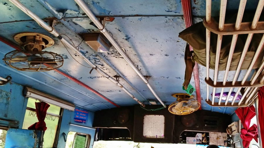 in the bus Fan Ventilator Old Bus Abandoned Absence Ceiling Clothing Creativity Damaged Day Decoration Electric Lamp Hanging Human Representation Indoors  Lighting Equipment Local Bus Low Angle View Multi Colored No People Old Color Sunlight Technology