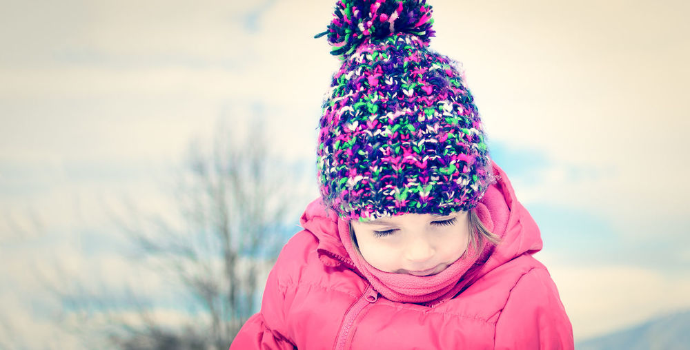 Close-up portrait of girl in winter