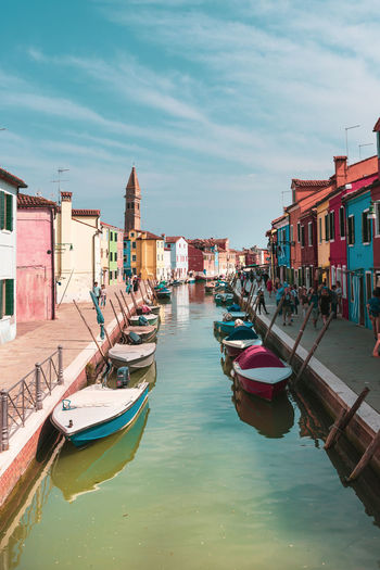 I love Burano Island ?! Have you ever been there ? Boats⛵️ Colourful Boats Building Exterior Built Structure Burano Canal City Cloud - Sky Day Island Italy Mode Of Transportation No People Reflection Rowboat Sailing Sky Tones Transportation Urban Venice Water Waterfront Wooden Post