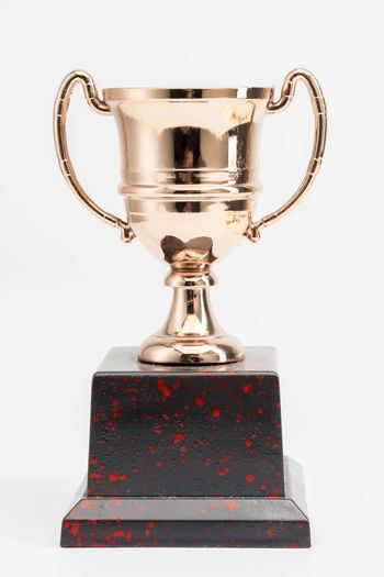 Trophy Cup on white background Studio Shot Indoors  Trophy Still Life AWARD White Background Single Object Success Winning Shiny Metal Achievement No People Close-up Gold Colored Cup Text Cut Out Competition Communication Silver Colored
