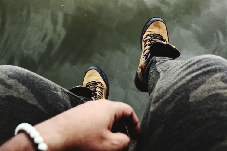 Relaxing in nature Low Section Men Human Leg Standing Canvas Shoe Shoe Jeans Personal Perspective Close-up Sock Shoelace Footwear Human Feet Human Foot Things That Go Together Human Toe Feet Wooden Floor Legs Crossed At Ankle Pair