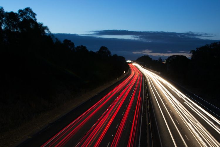 Blurred Motion High Angle View Highway Illuminated Light Trail Long Exposure Motion Night Lights Night Trails Nightphotography Red Road Sky Speed Sunset Tail Light Traffic