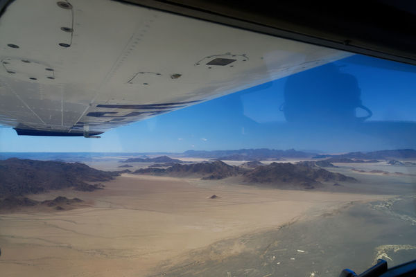 Zooming in to a new adventure Nikon Air Vehicle Airplane Beauty In Nature Blue Day Desert Landscape Flying Landscape Nature No People Outdoors Scenics Sky