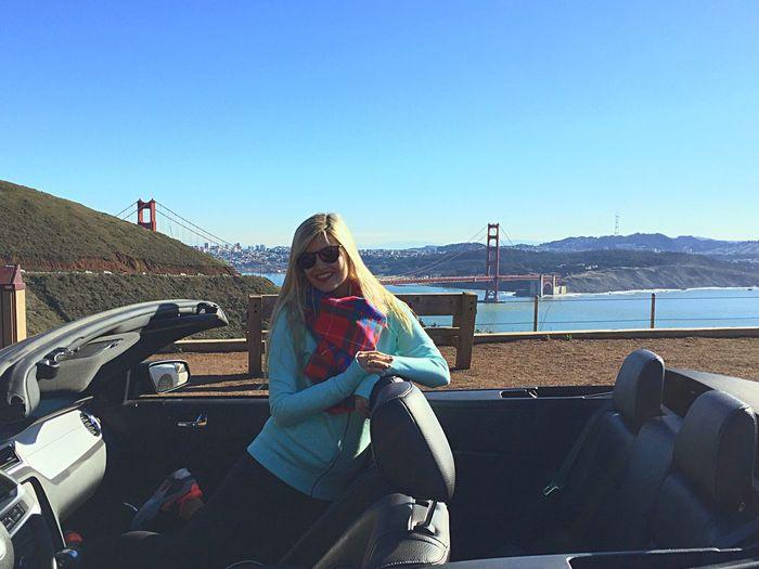 Happy Kneeling On Seat In Convertible Car