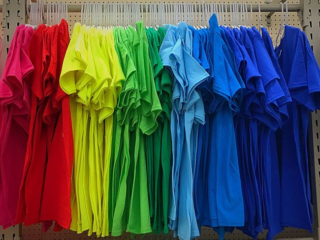 Rainbow shirts just hangin around ~~~ Multi Colored Large Group Of Objects Variation Store Retail  Hanging For Sale Choice Vibrant Color Clothing Textile Business Finance And Industry Abundance Consumerism Arrangement No People Coathanger Blue Neat Day