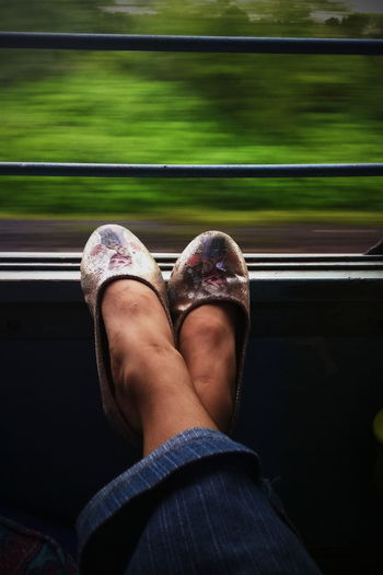 Low section of woman in train