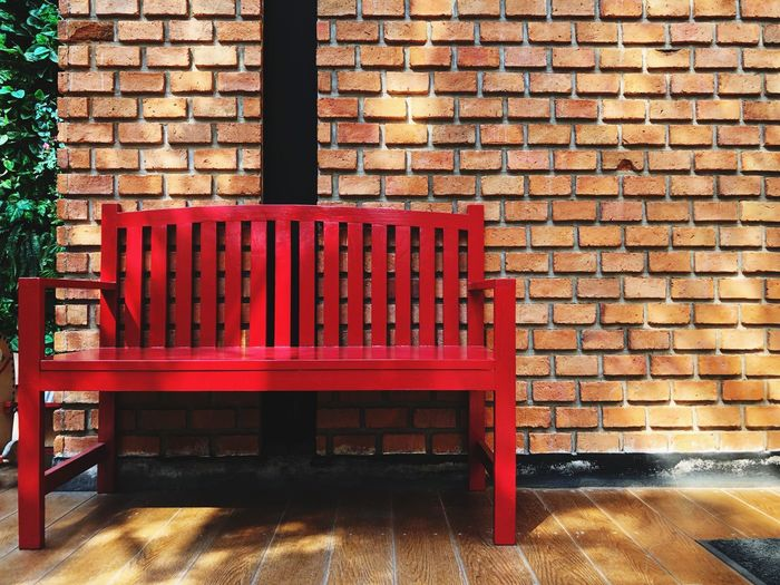Empty Red wood chair on brick wall background Chairs Seats Seat Garden Outdoor Photography Brick Wall Wall Brick Shadow Seat Wall - Building Feature Architecture